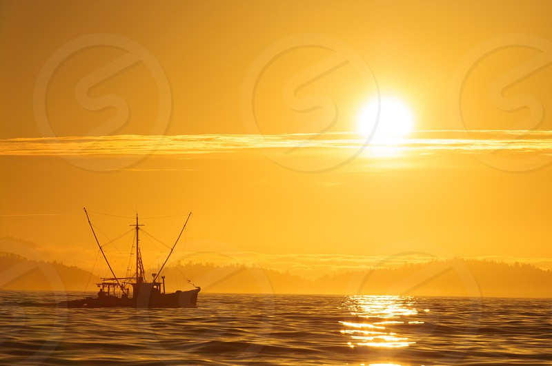 A fishing boat at sunrise. photo
