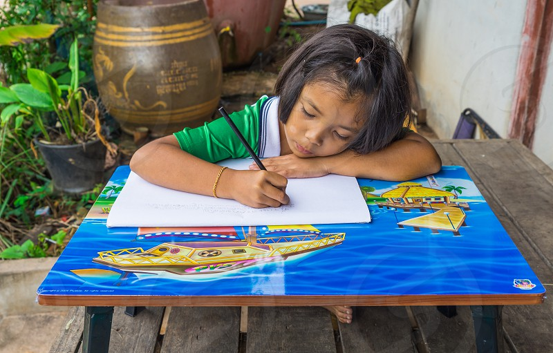 School kid doing homework. photo