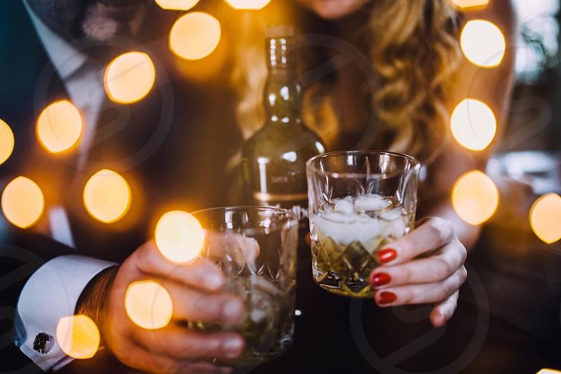 Celebration party couple drinks alcohol lights nightlife whiskey  photo