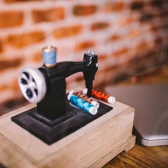 Close-up of miniatur sewing machine photo