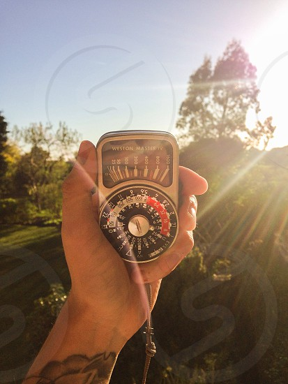 Vintage analogue light meter Weston master nature England summer sunshine lens flare warm golden light  photo