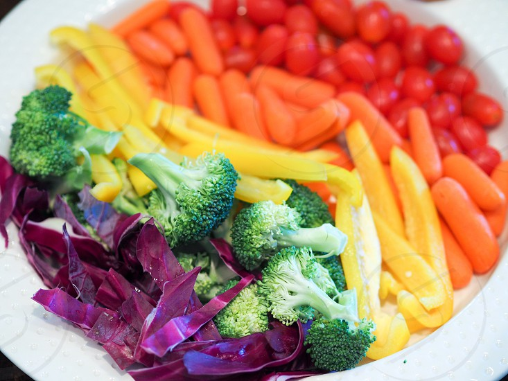 broccoli onions and beans in white plater photo