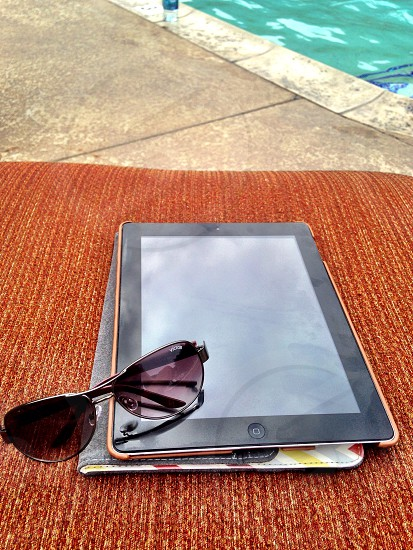 ipad by pool side photo