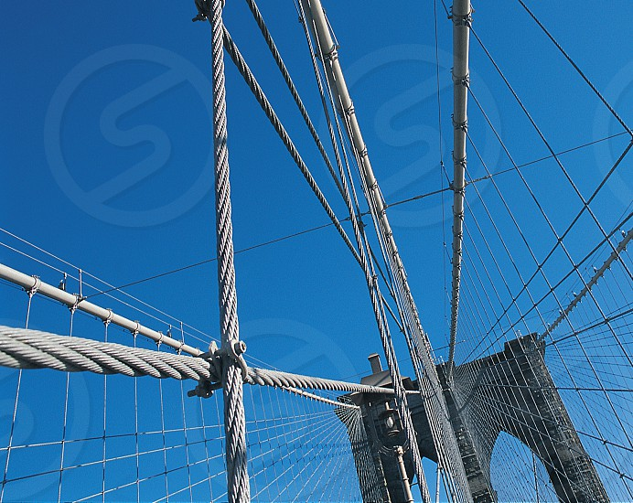 The Brooklyn Bridge is one of the oldest suspension bridges in the United States.  Completed in 1883 it connects the New York City boroughs of Manhattan and Brooklyn. photo