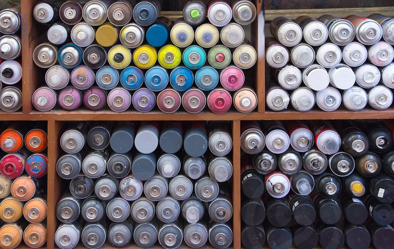spray paint paint cans spray cans graffiti artist art murals street art street artist visual communication photo