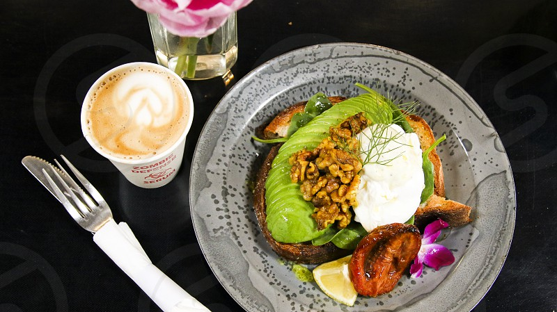 Avocado toast with latte overhead photo