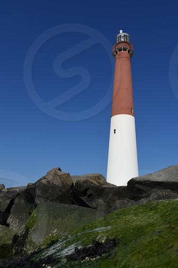 light house under clear blue sky during daytime photo
