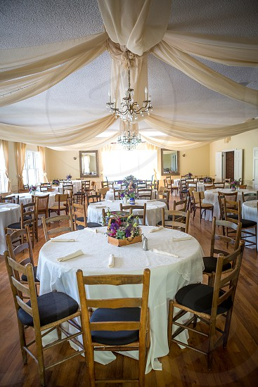Reception venue tables chairs empty room room empty details dining room large dining  photo