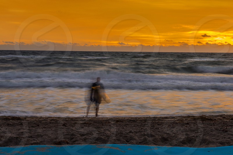 Surfing surfer ocean sunrise photo