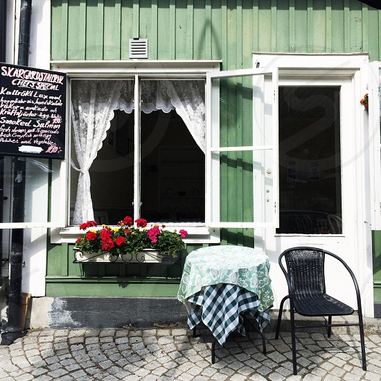 Green timber building cafe restaurant vaxholm stockholm Sweden photo