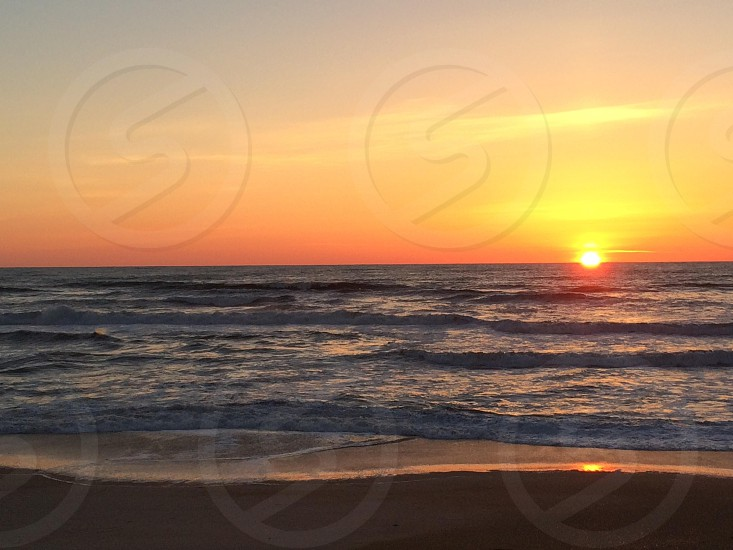 Sunrise on the beach at Corolla NC photo