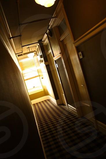 hotel corridor dark window narrow day light doors photo
