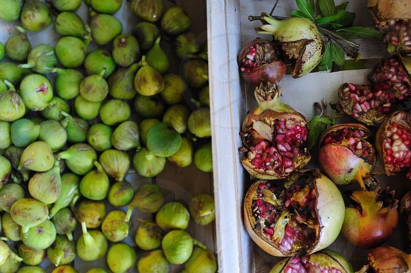 Fresh picked pomegranates and figs. photo
