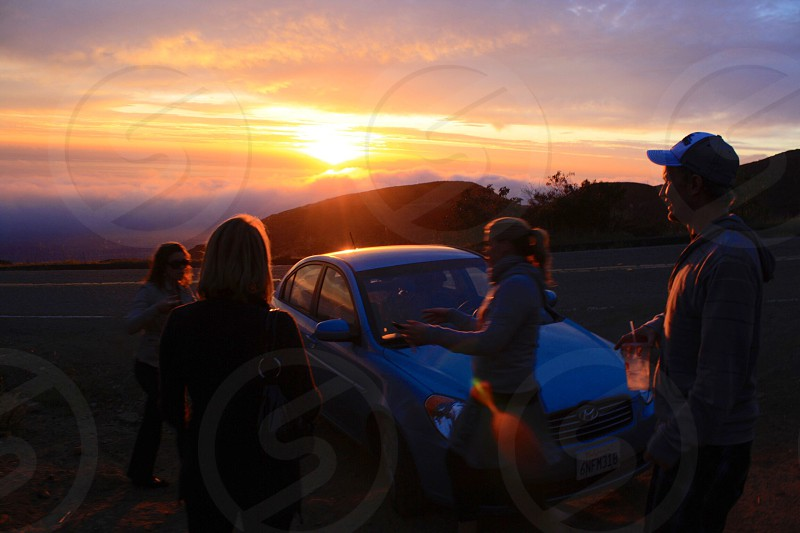 group of people beside car during golden hour photo