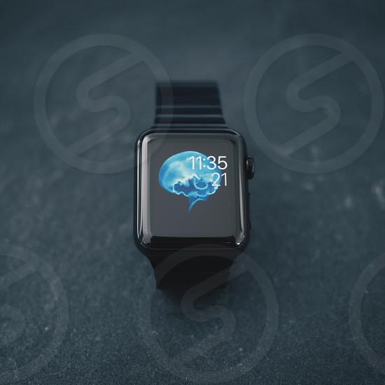 black apple iwatch reading 11:35 on gray ground photo