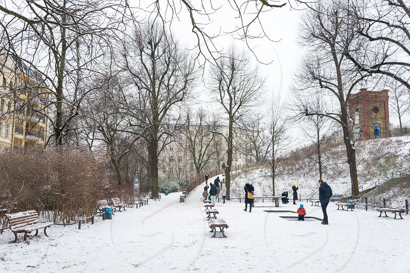 Scenery and outdoor activities around Wasserturm durning winter season inside Prenzlauer Berg Neighborhood in Berlin Germany photo