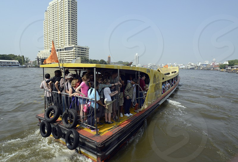 a Transport passanger boat at the Mae Nam Chao Phraya River in the city of Bangkok in Thailand in Southeastasia. photo