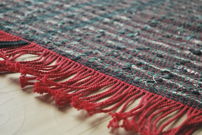 brown black and red area rug photo