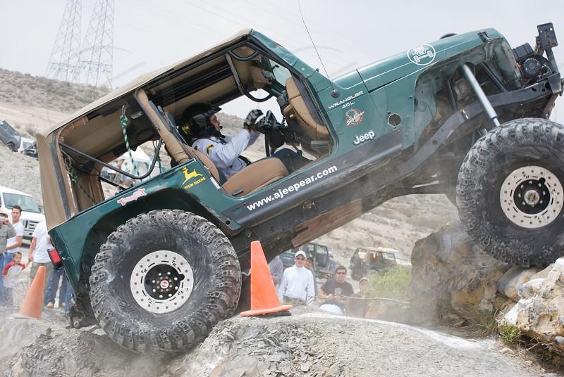 green jeep wrangler rock crawling photo