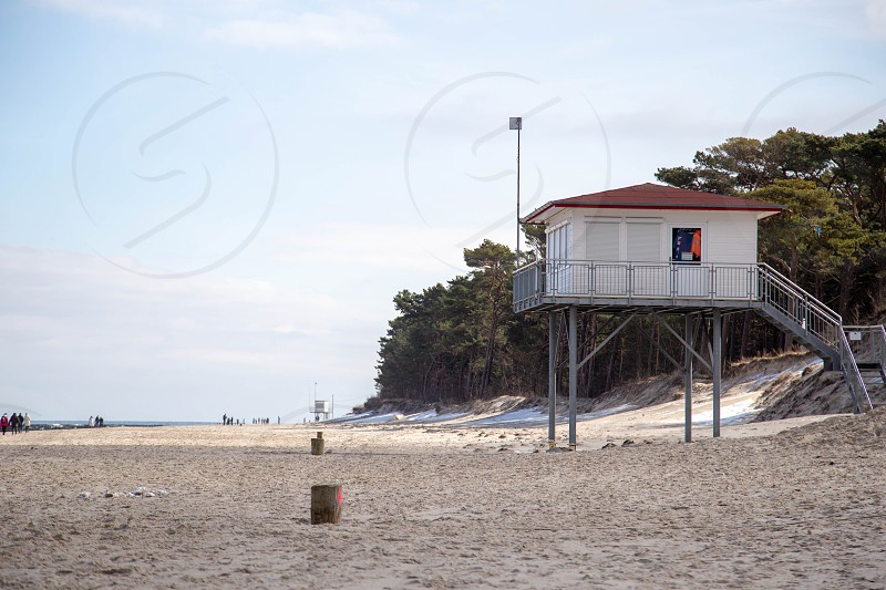 a lifeguard watch tower on the beach of the Baltic Sea photo