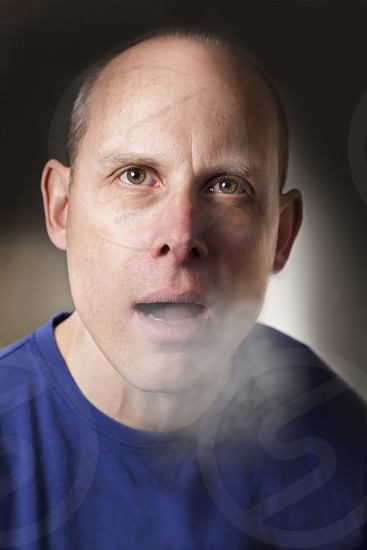 man in blue t shirt photo