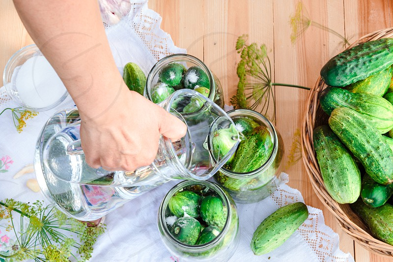 Pickling cucumbers with home garden vegetables and herbs photo
