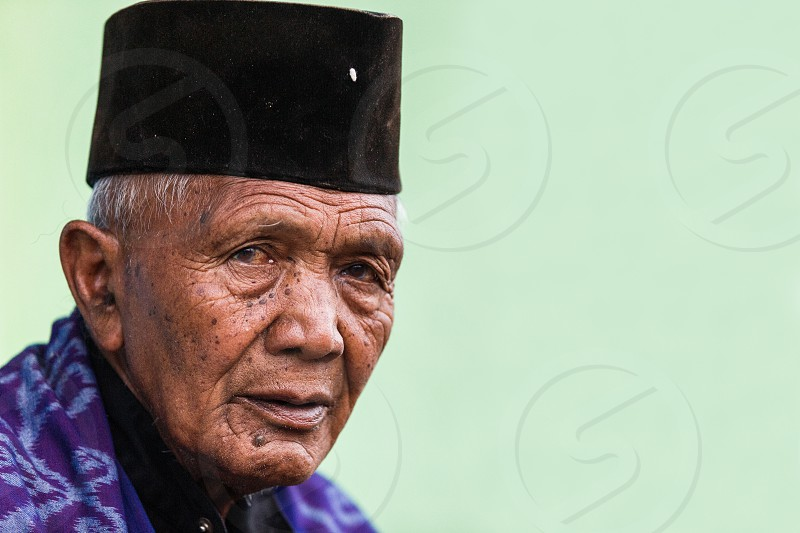 hat travel wise wrap horizontal east old cemorolawang people village traditional asia dress face color smoke country tourism portraiture java man diversity cultural indonesia portrait look asian photo