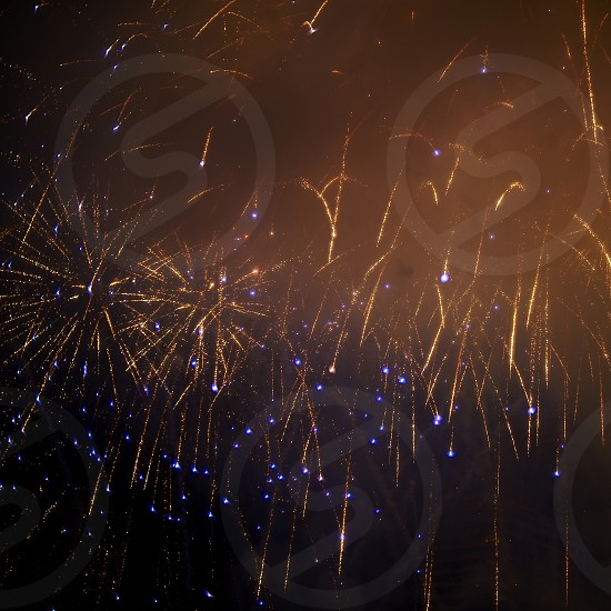 Amazing fireworks show exploding into stunning patterns in the night sky for New Year celebration photo
