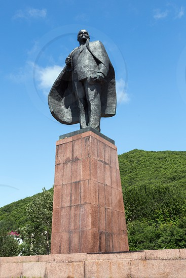 PETROPAVLOVSK-KAMCHATSKY KAMCHATKA RUSSIA - JULY 18 2012: A statue monument to Vladimir Ilyich Ulyanov (Lenin alias) - Russian and Soviet politician and statesman communist revolutionary political theorist. View of monument on sunny day. photo