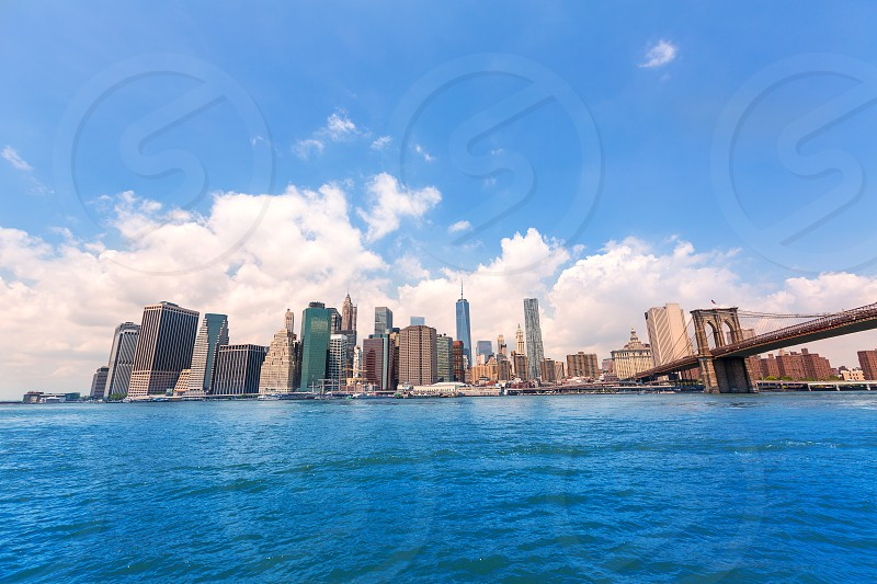 Brooklyn Bridge and Manhattan skyline New York city sunshine US photo