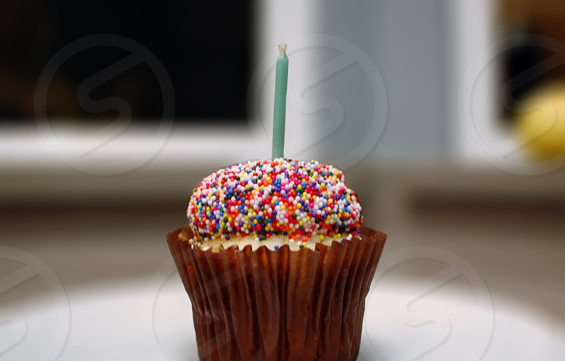 Cupcakes sprinkles candlecolorful  photo