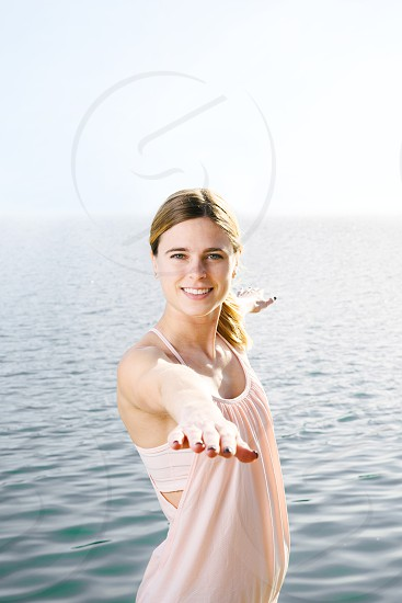 Beautiful woman outdoors neat the water. Edits available. photo