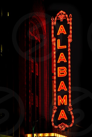 red alabama theater neon sign at night photo