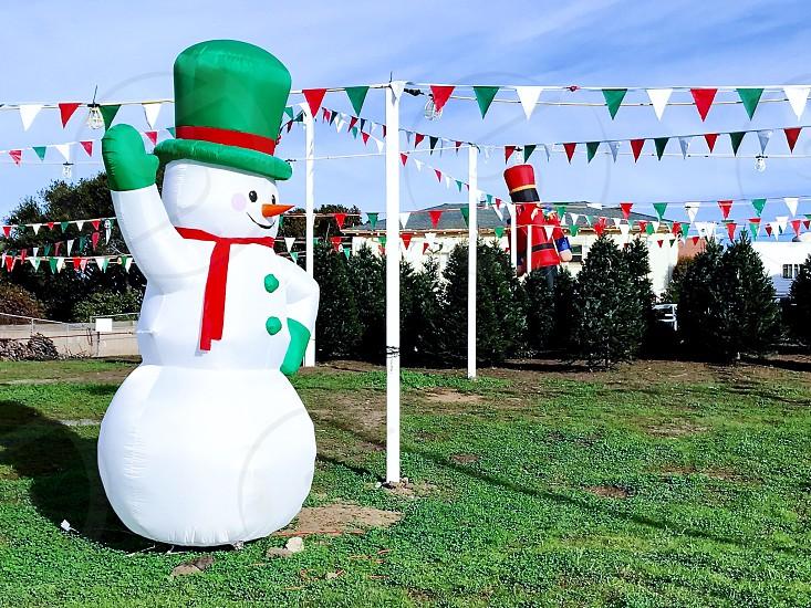 Christmas tree yard inflatable snowman  photo