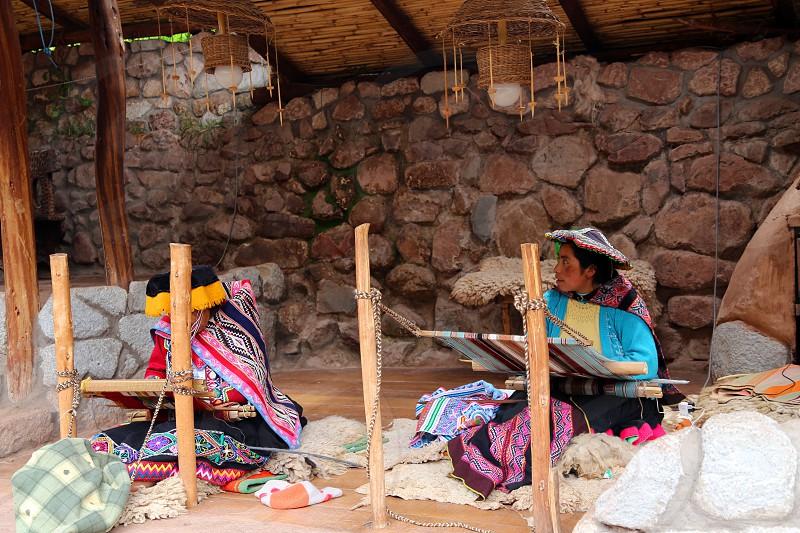 Peruvian women working on handmade rugs in atextile factory photo