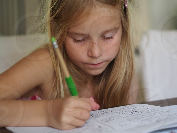 Drawing concentrated focused girl child kid daughter Sweden photo