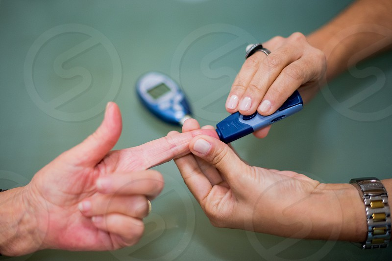 Checking blood sugar  photo