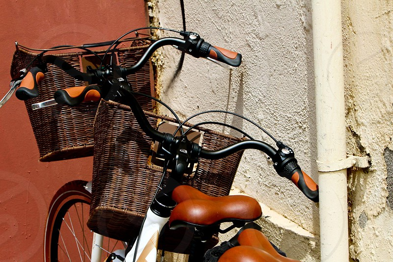 two bicycles on wall photo