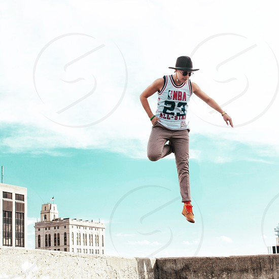 Rooftop jump urban city skyline sky photo