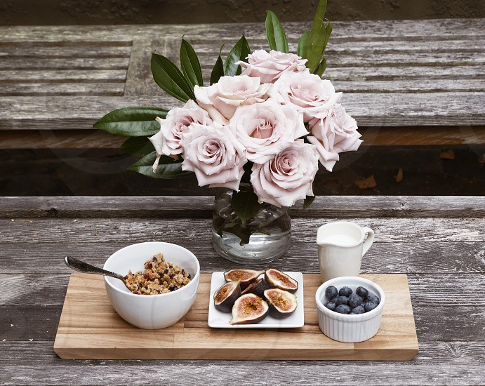 Pink roses figs granola blueberries breakfast healthy eating organic food photo