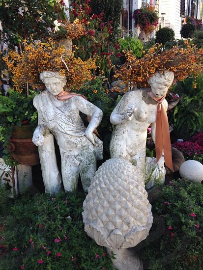 Autumn humor - dress up autumn fall seasonal fun statues decoration silly wreath happy photo