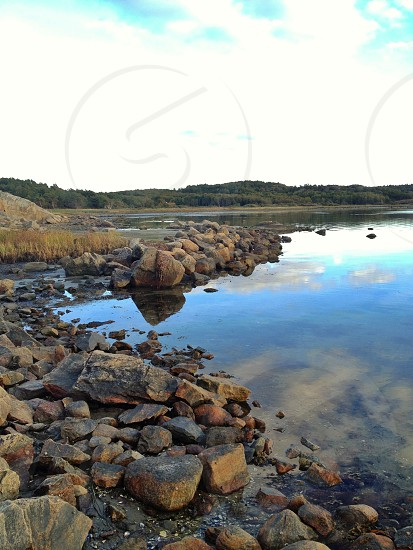 small and medium rocks on water photo