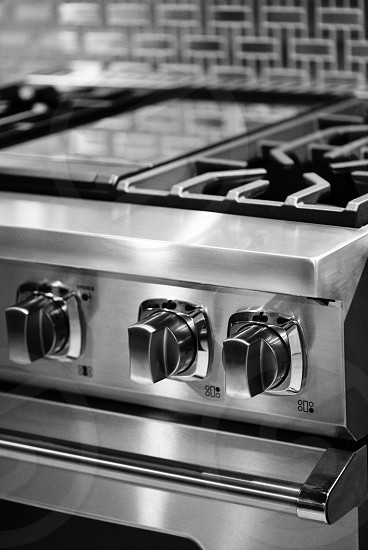 stainless steel gas range close up photography photo