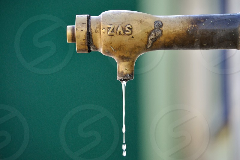 dripping water from brass pipe photo