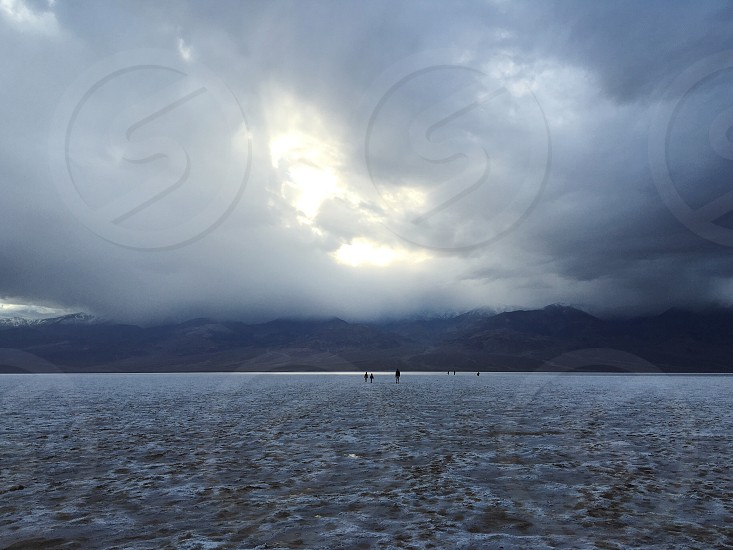 death valley salt lake cloudy serene photo