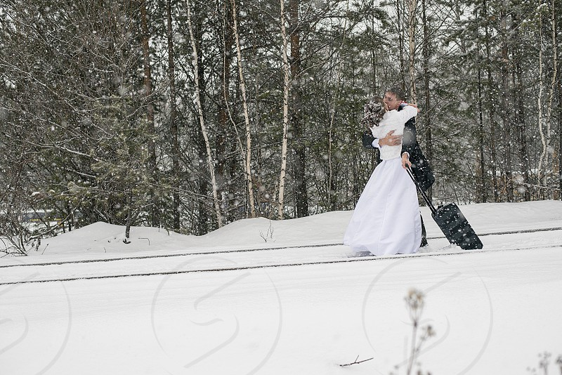 symbol love wedding tradition ceremony outdoor day winter snow ceremony bride and groom kiss feelings family photo
