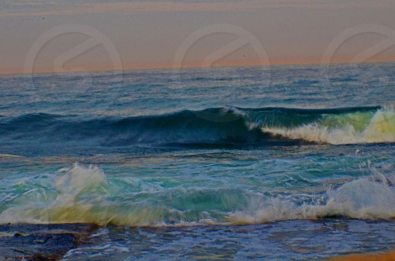 waterwavesbeachsunsetoceanlandscape photo