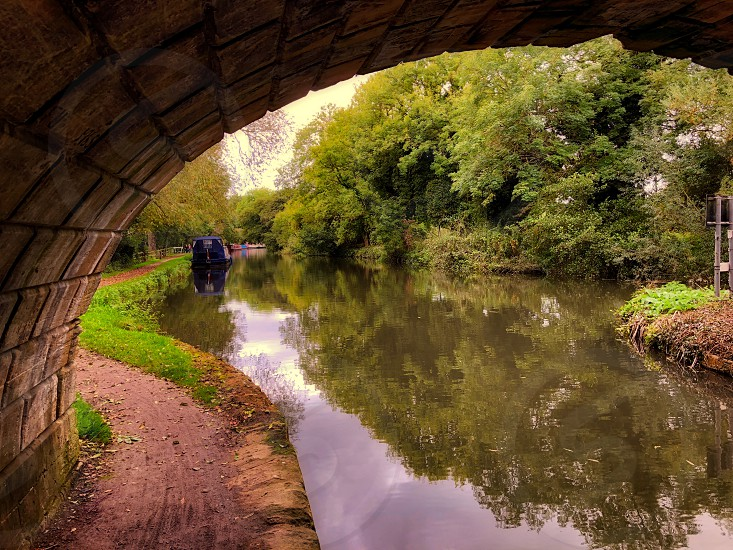 Looking under a canal bridge photo