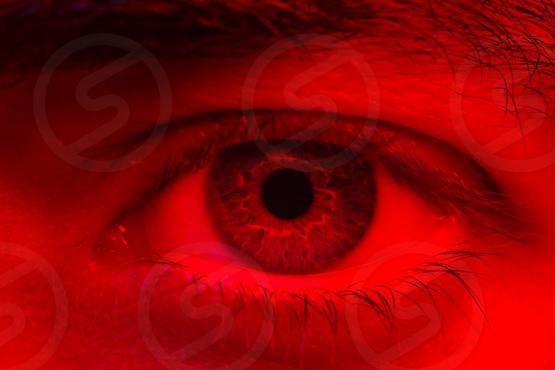 Macro on man eye expressing serious and expressionless expression. photo