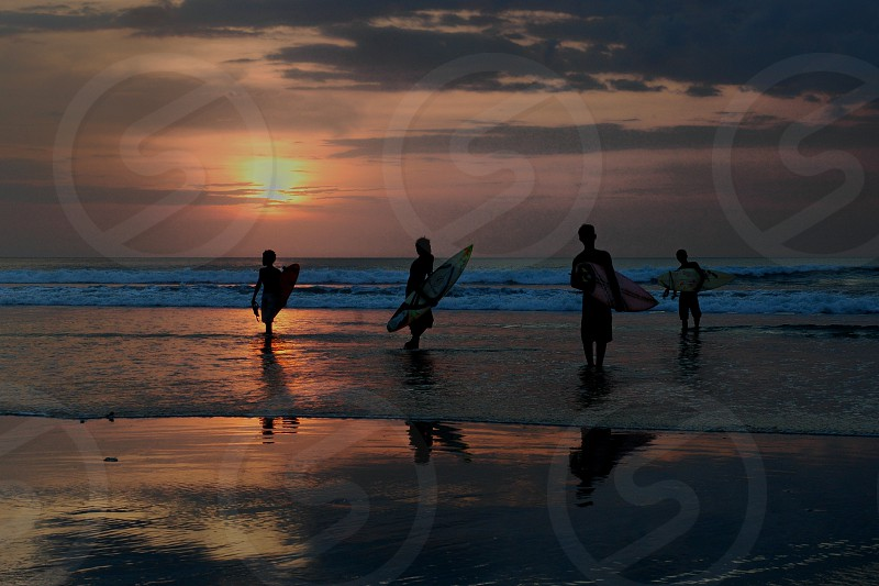 enjoy the beach and sunset in Bali photo